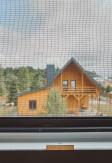 Moskitiera okienna kołnierzowa antracytowa wykonana na dokładny wymiar.
